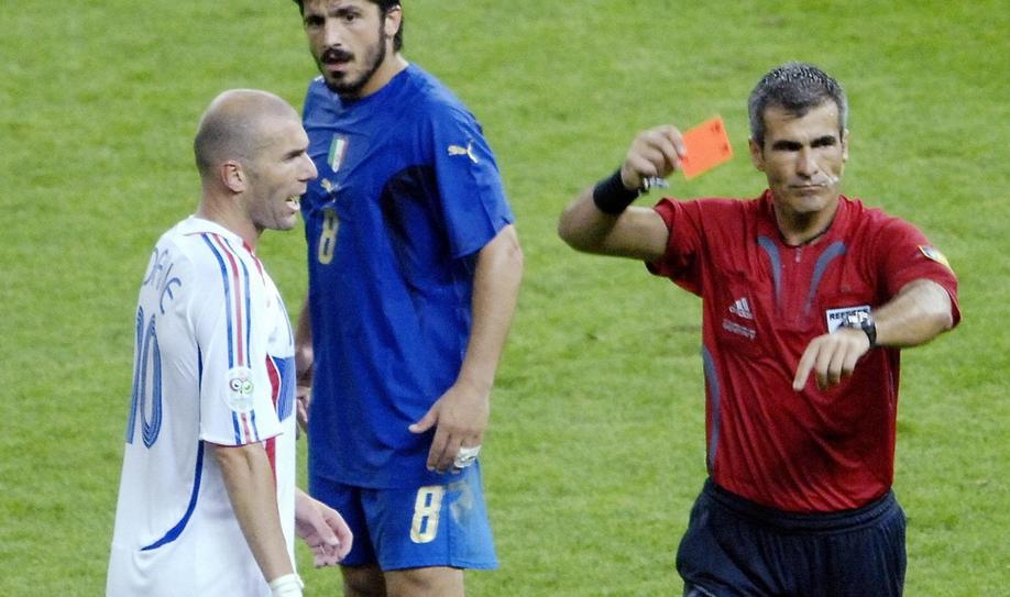 Referee Horacio Elizondo of Argentina shows France's Zinedine Zidane (R) a red card during their World Cup 2006 final soccer match against Italy in Berlin July 9, 2006