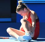 Halep faces nervous wait over ankle injury