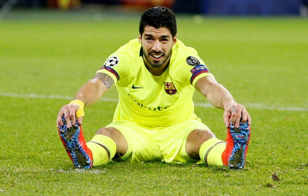 Barcelona's Luis Suarez reacts with frustration during Champions League clash with Olympique Lyon