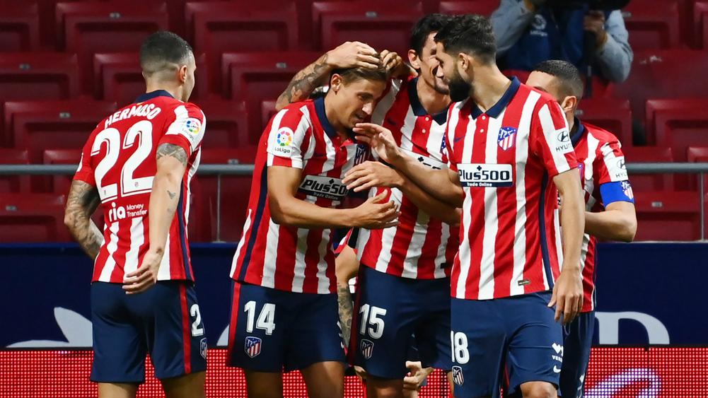 Atletico Madrid 2-0 Real Betis: Llorente and Suarez strike to seal new club record