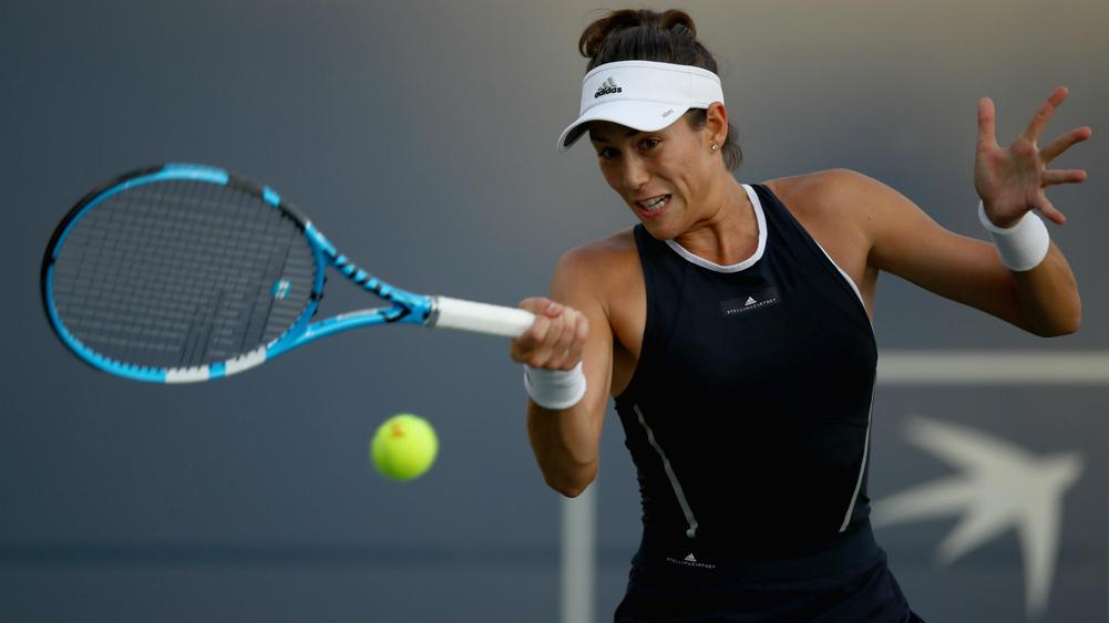 Wimbledon champion Muguruza wins in 1st match back