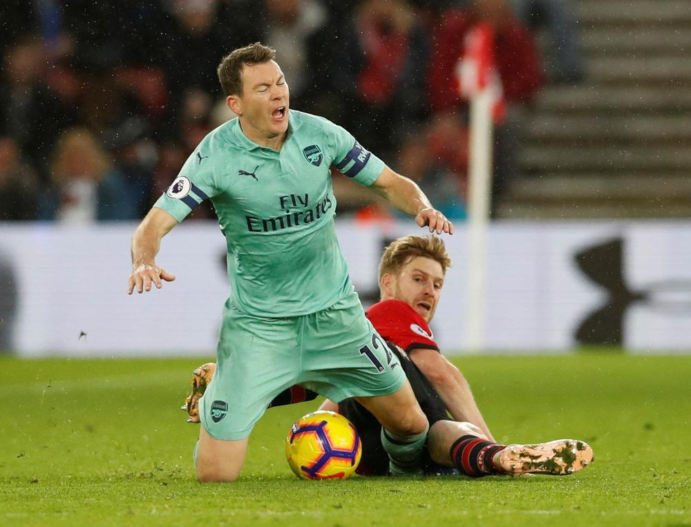 Arsenal's Stephan Lichtsteiner is fouled by Southampton's Stuart Armstrong