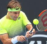 Ferrer beaten in Montpellier, Simon edges through