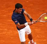 Out-of-sorts Djokovic survives inspired Simon