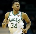 Giannis shows MVP credentials, Warriors crush Spurs