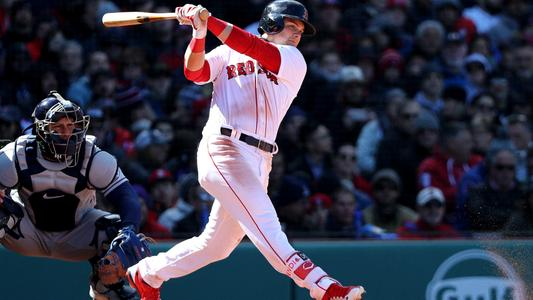 Andrew Benintendi of the Red Sox cracks a hit at the plate | Brian M. Reiser