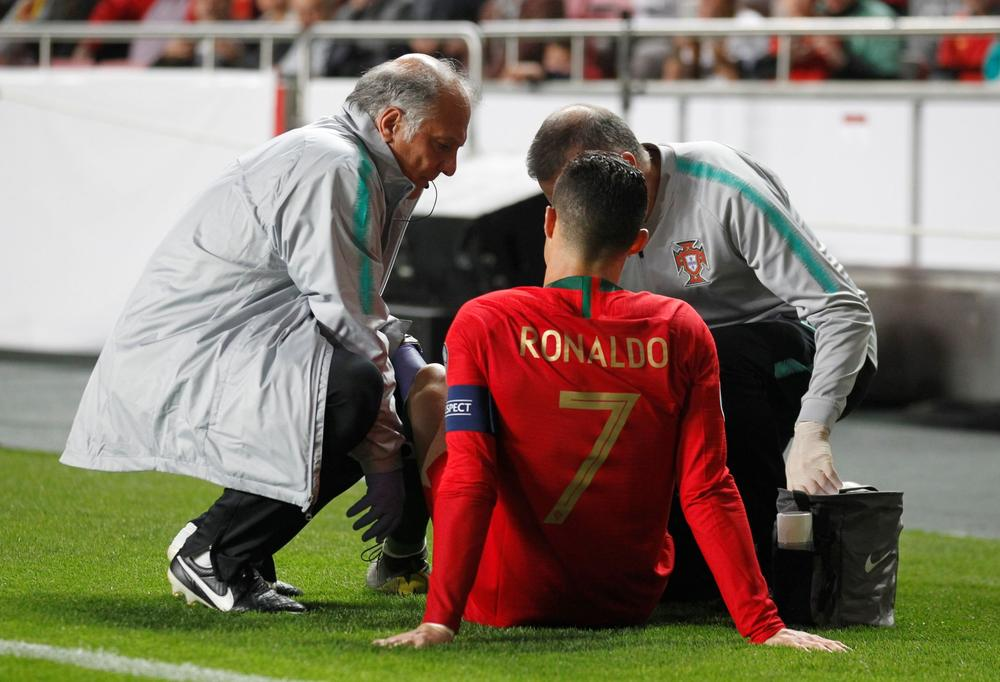 Cristiano Ronaldo receives treatment from medical staff during Portugal's Euro 2020 qualifier match with Serbia, March 25, 2019 | beIN SPORTS USA