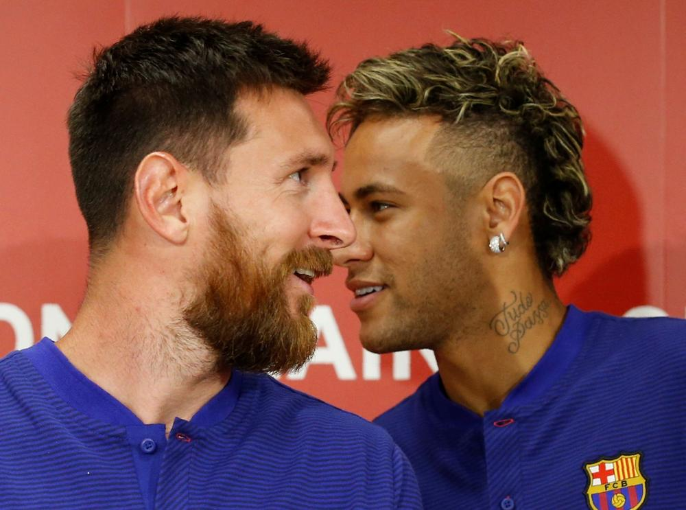 FC Barcelona players Lionel Messi (L) and Neymar attend a news conference to announce the sponsorship deal between the team and Japanese e-commerce operator Rakuten Inc. in Tokyo, Japan July 13, 2017