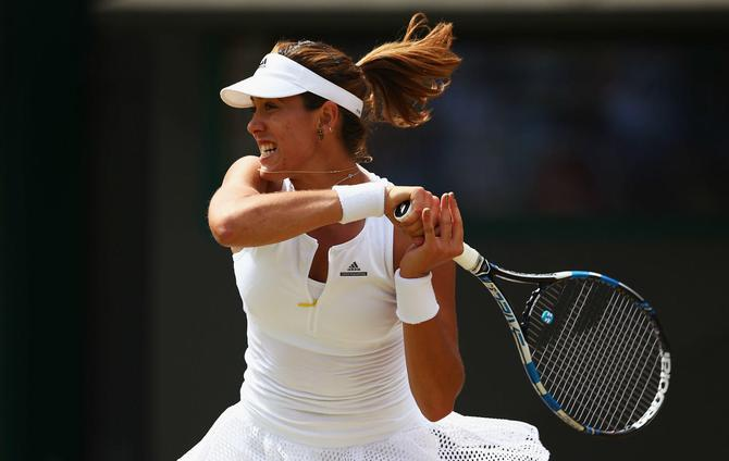 Muguruza moves into maiden Wimbledon semi-final
