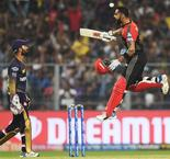 Kohli hits century as Challengers survive Russell onslaught