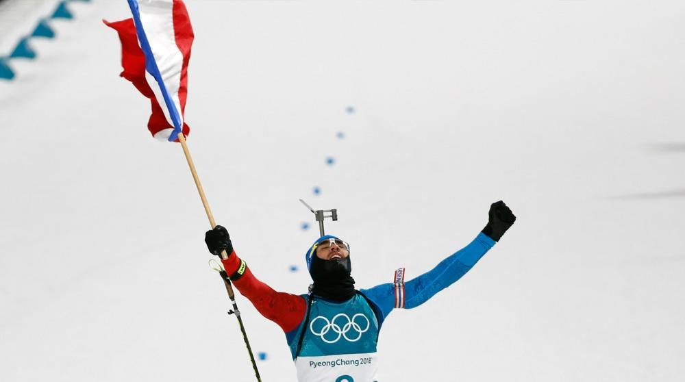 Martin Fourcade makes Olympic biathlon history with pursuit gold