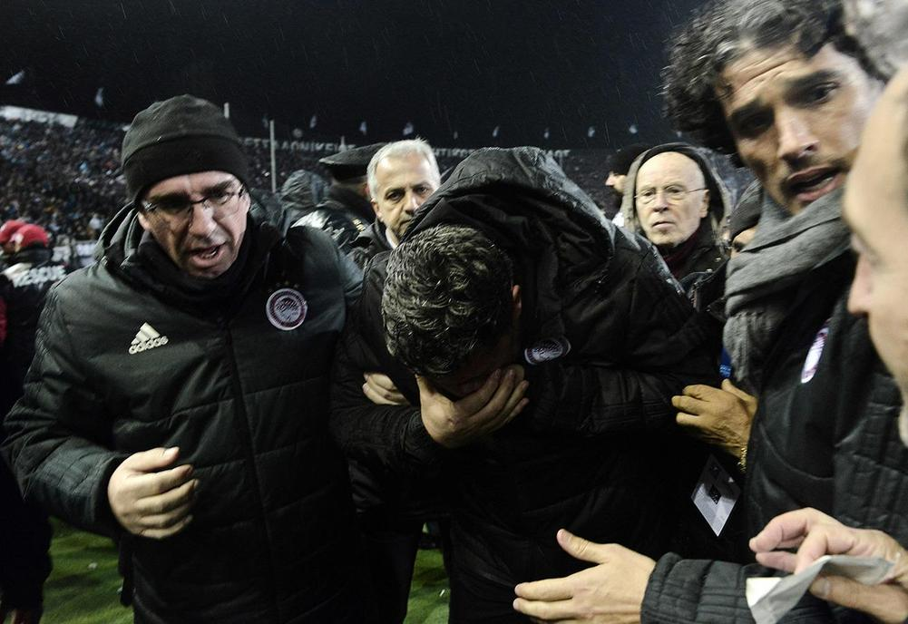 Greek match postponed after coach injured by toilet roll