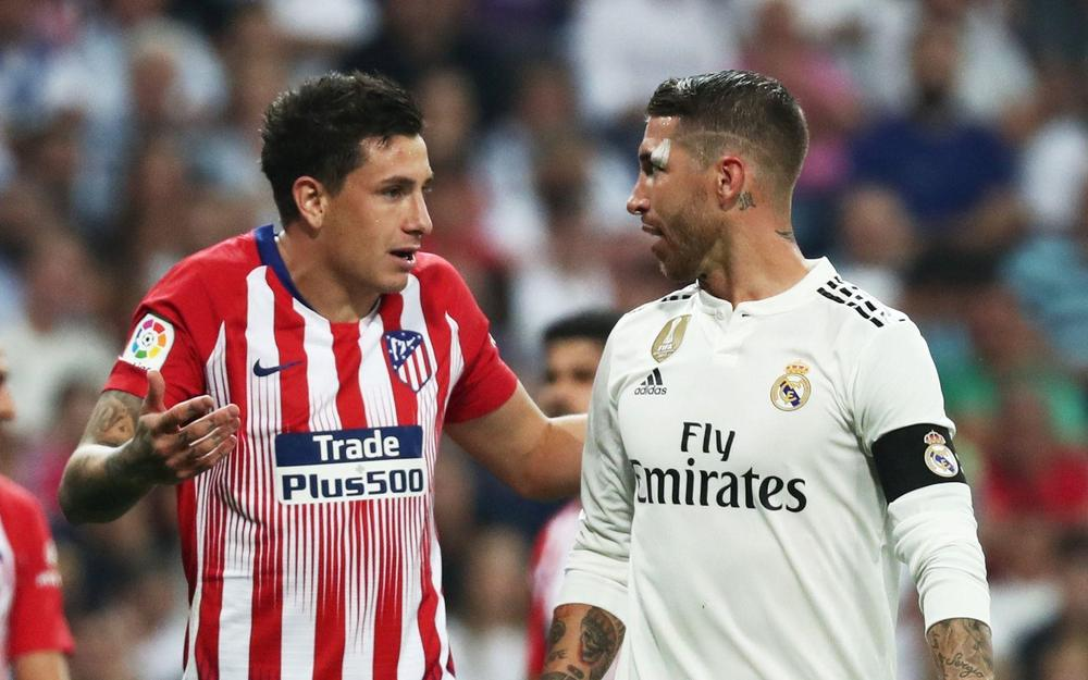 Atletico Madrid's Jose Maria Gimenez (left) speaking with Real Madrid captain Sergio Ramos