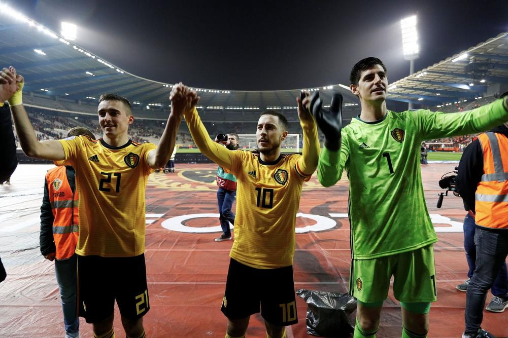 Soccer Football - Euro 2020 Qualifier - Group I - Belgium v Russia - King Baudouin Stadium, Brussels, Belgium - March 21, 2019 Belgium's Timothy Castagne, Eden Hazard and Thibaut Courtois celebrate after the match REUTERS/Francois Lenoir | beIN SPORTS