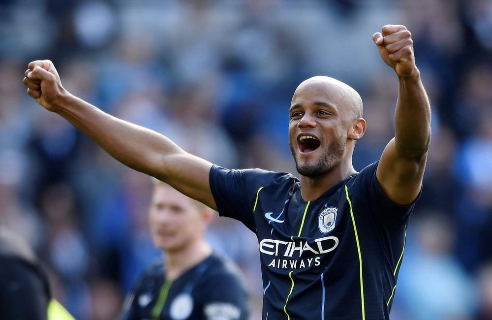 Soccer Football - Premier League - Brighton & Hove Albion v Manchester City - The American Express Community Stadium, Brighton, Britain - May 12, 2019 Manchester City's Vincent Kompany celebrates winning the Premier League REUTERS/Toby Melville  | beIN SP