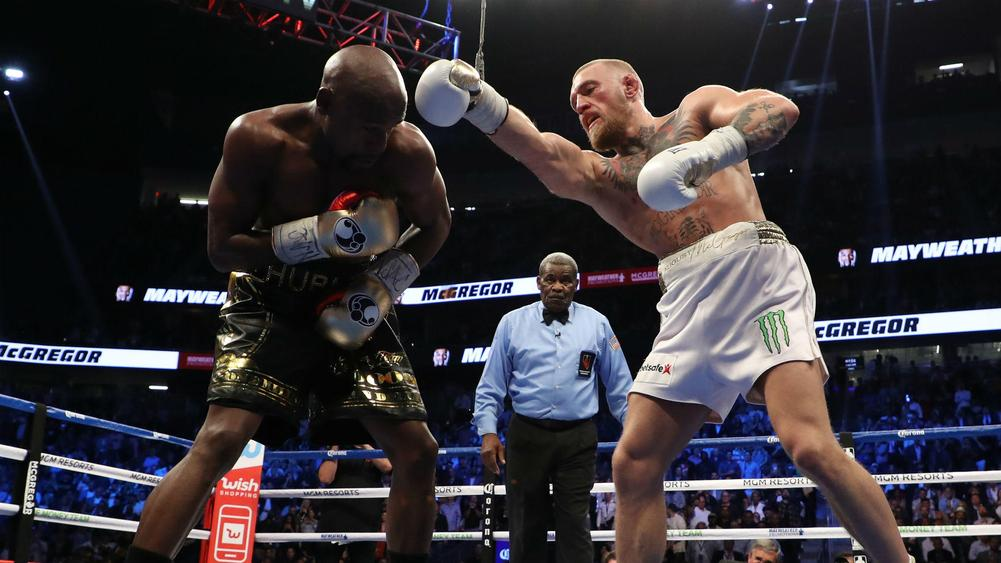 Floyd Mayweather defeats Conor McGregor by TKO