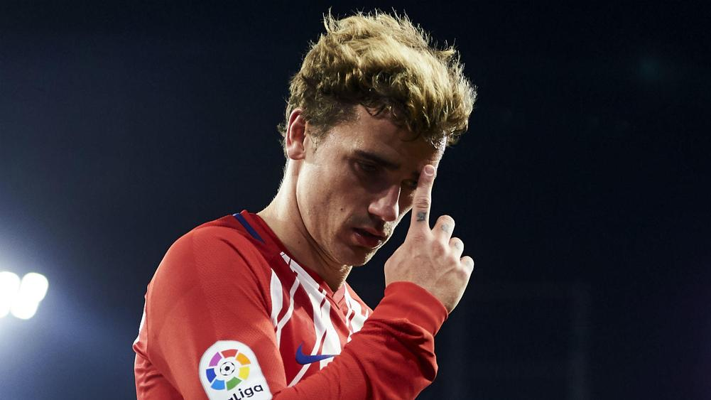Atletico holds Real Madrid 1-1 in fight for 2nd place