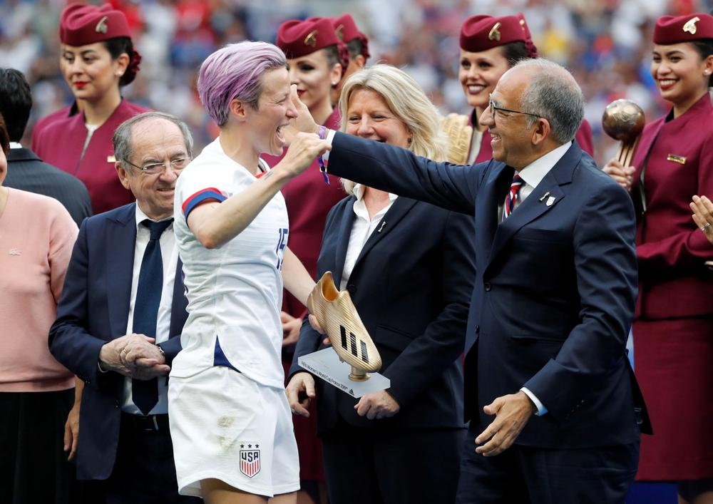 United States striker Megan Rapinoe celebrates with USSF president Carlos Cordeiro after winning the FIFA Women's World Cup | beIN SPORTS USA
