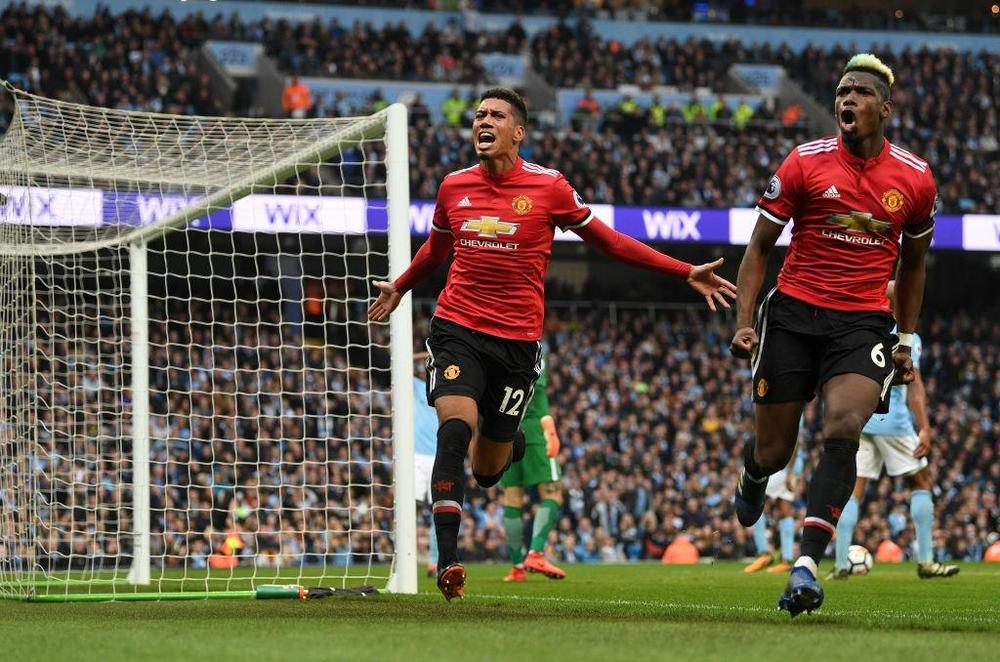 Chris Smalling dan Paul Pogba, Manchester City vs. Manchester United