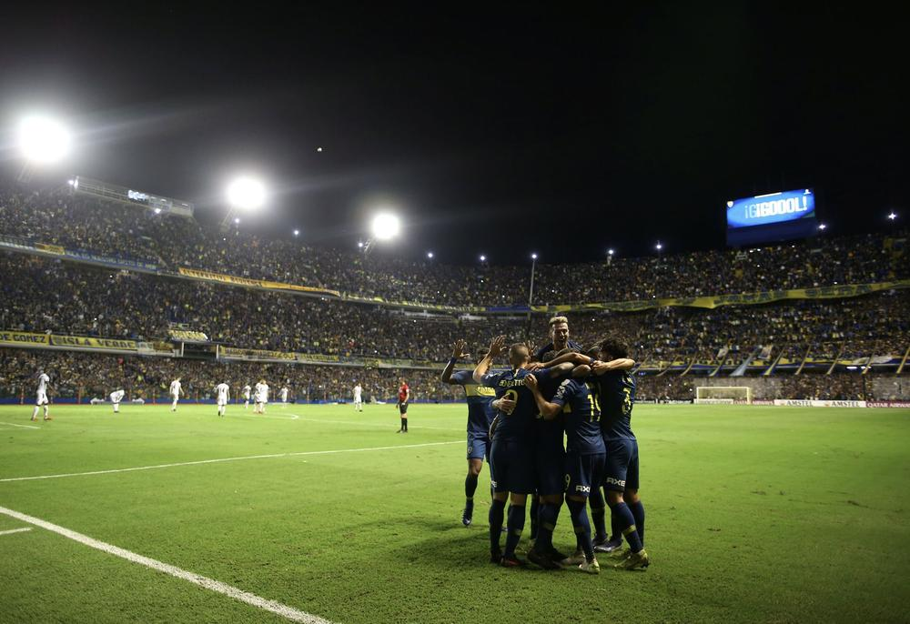 Soccer - Copa Libertadores - Group Stage - Group G - Boca Juniors v Deportes Tolima - Alberto J. Armando Stadium, Buenos Aires, Argentina - March 12, 2019 Boca Juniors' Mauro Zarate celebrates scoring their third goal with team mates REUTERS/Agustin Marca