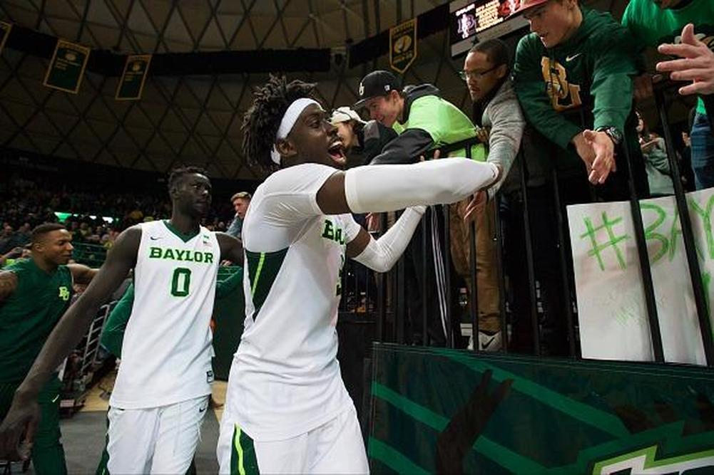 WACO, TX - JANUARY 7: Johnathan Motley #5 and Jo Lual-Acuil Jr. #0 of the Baylor Bears celebrate after defeating the Oklahoma State Cowboys 61-57 on January 7, 2017 at the Ferrell Center in Waco, Texas. (Photo by Cooper Neill/Getty Images)