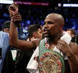 Mayweather stops McGregor for record-breaking 50th win in Las Vegas classic