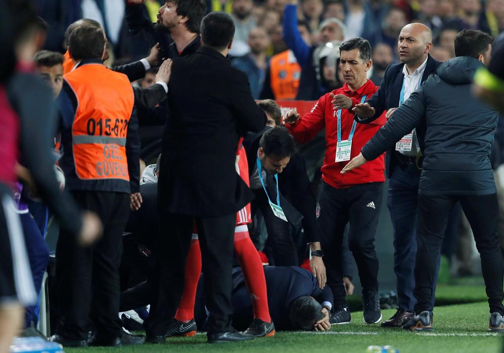 Besiktas coach hit on the head by object as Fenerbahce game abandoned