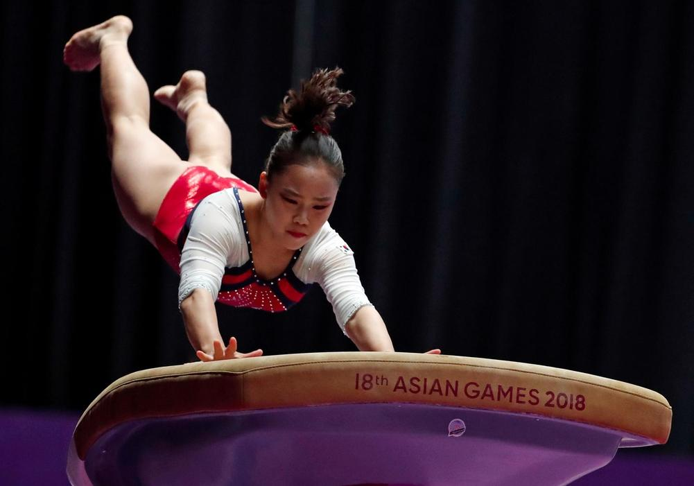Teen pips 43-year-old gymnast to Asian Games gold