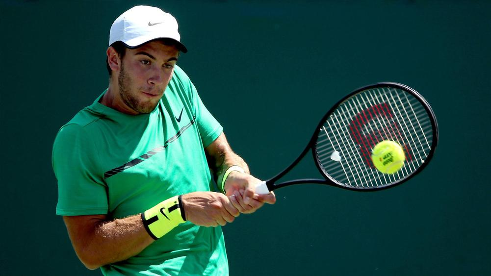 Coric saves 5 match points to win 1st tour title