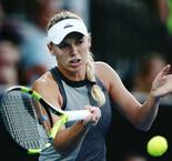 Impressive Wozniacki eases past Brengle