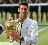 Djokovic seals Wimbledon title after five set epic with Federer