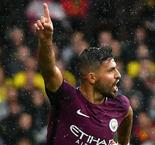 Aguero hat-trick sends City flying to the top