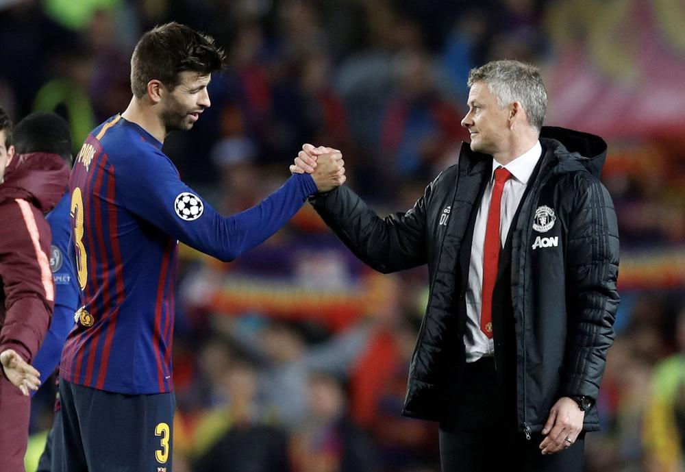 Soccer Football - Champions League Quarter Final Second Leg - FC Barcelona v Manchester United - Camp Nou, Barcelona, Spain - April 16, 2019 Manchester United manager Ole Gunnar Solskjaer with Barcelona's Gerard Pique after the match | beIN SPORTS