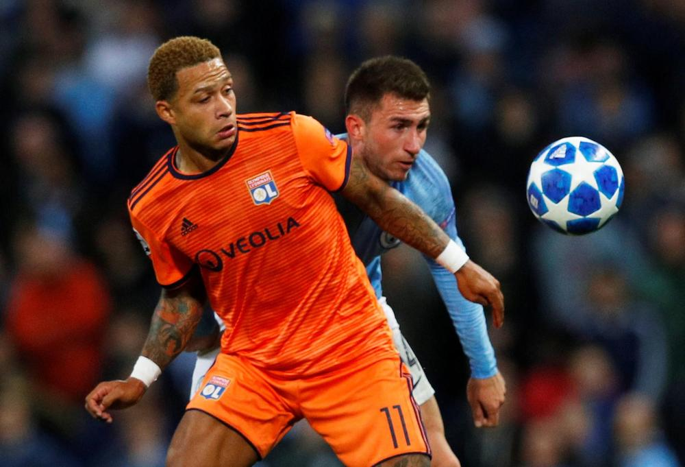 Manchester City v Olympique Lyonnais - Etihad Stadium, Manchester, Britain - September 19, 2018 Lyon's Memphis Depay in action with Manchester City's Aymeric Laporte
