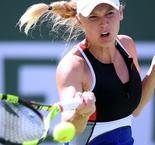 Out-of-sorts Wozniacki muddles through against Sasnovich