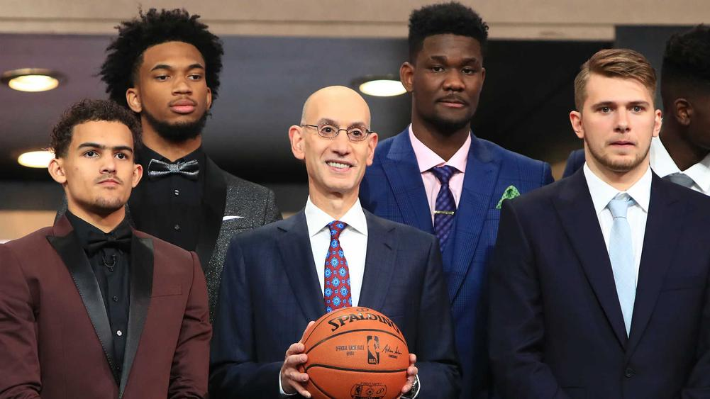 Trae Young, from left, Marvin Bagley III, Adam Silver, Deandre Ayton and Luka Doncic