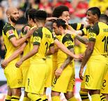 Rampant Dortmund keeps pace with Bayern
