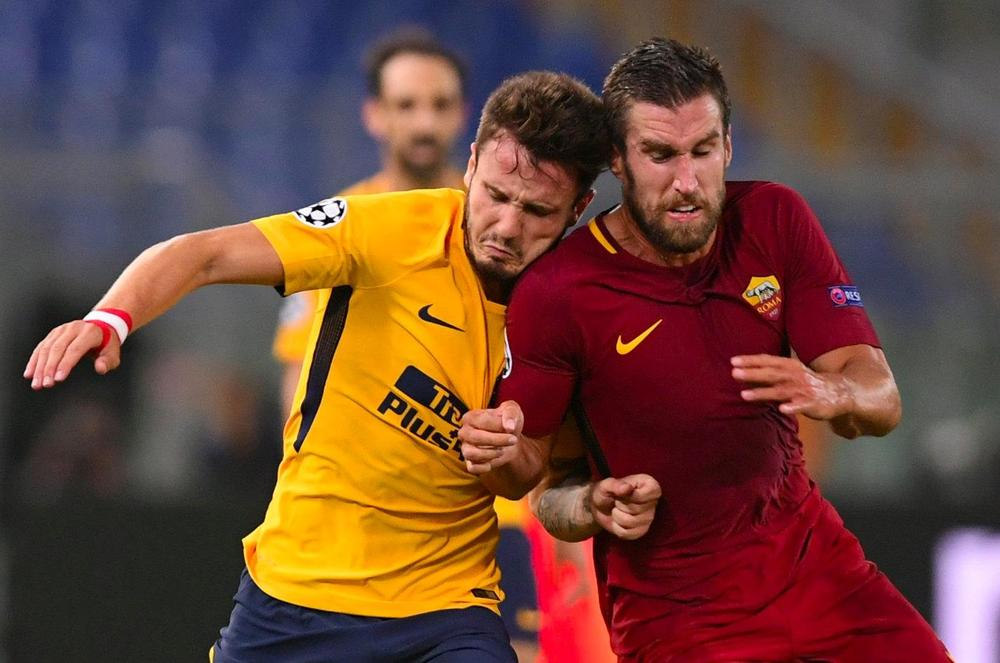 Saul Niguez and Kevin Strootman battle for possession