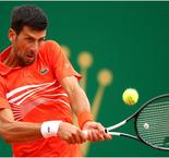 Djokovic breezes through in blustery Monte Carlo