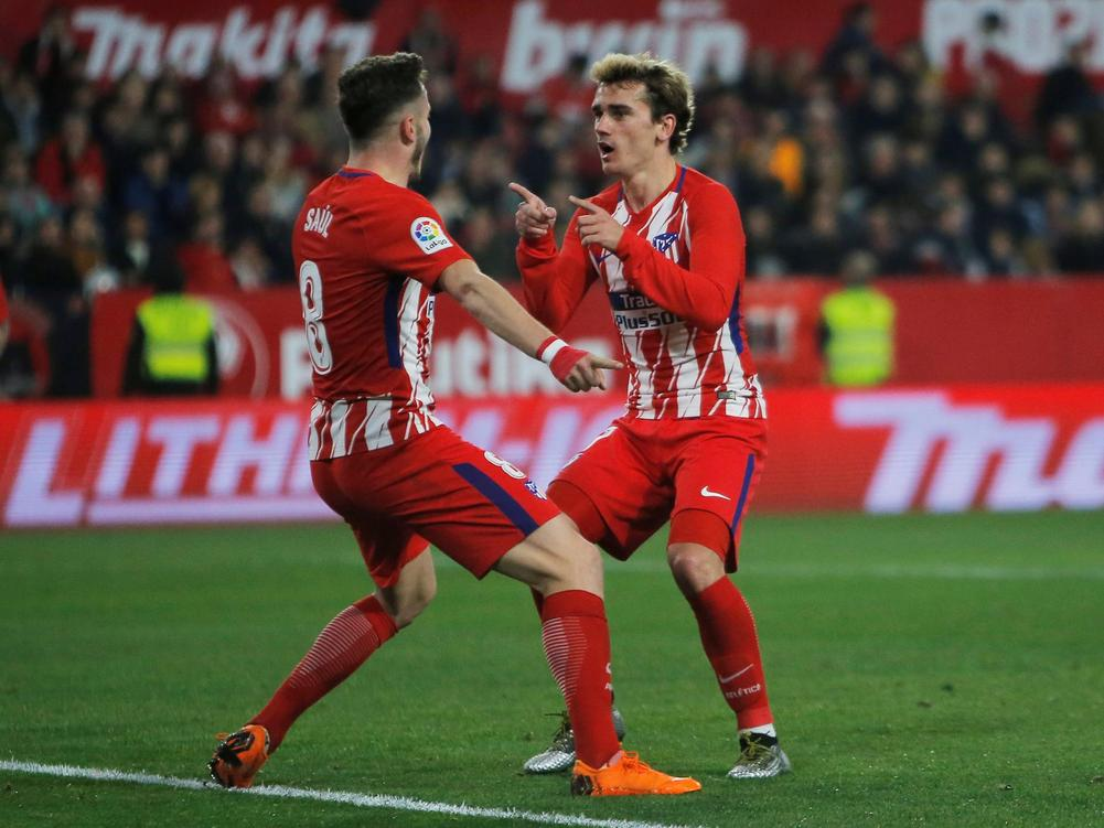 Atletico Madrid's Antoine Griezmann celebrates with Saul Niguez after scoring their fifth goal to complete his hat-trick