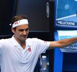 Federer battles into Australian Open third round