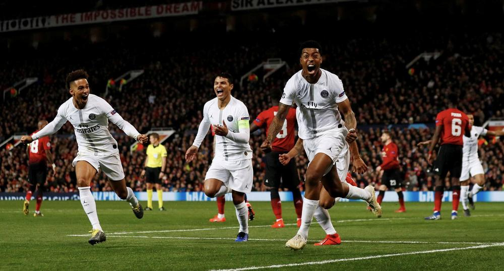 Manchester United v Paris St Germain - Old Trafford, Manchester, Britain - February 12, 2019 Paris St Germain's Presnel Kimpembe celebrates scoring their first goal with Thiago Silva and Thilo Kehrer Action Images via Reuters/Jason Cairnduff TPX IMAGES OF
