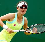 Zheng delights home fans with maiden WTA title