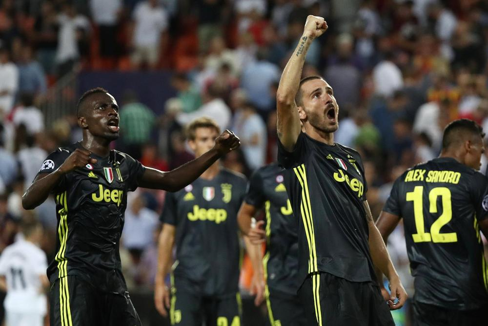 Juventus' Blaise Matuidi and Leonardo Bonucci celebrate after the match