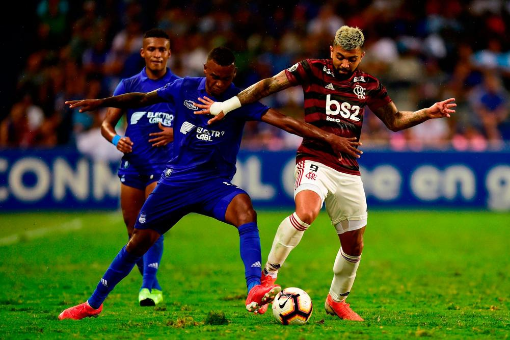 Brazil's Flamengo Gabriel Barbosa (R) vies for the ball with Ecuador's Emelec Dixon Arroyo during their Copa Libertadores football match at George Capwell Stadium in Guayaquil, Ecuador on July 24, 2019 | beIN SPORTS USA