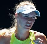 Wozniacki back from the brink, 15-year-old Kostyuk marches on