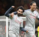 Hat-trick hero Salah sends Reds top