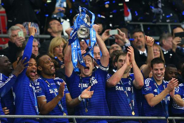 Jose Mourinho is back on the trophy trail with Chelsea after a 2-0 win over Tottenham sealed League Cup success at Wembley.