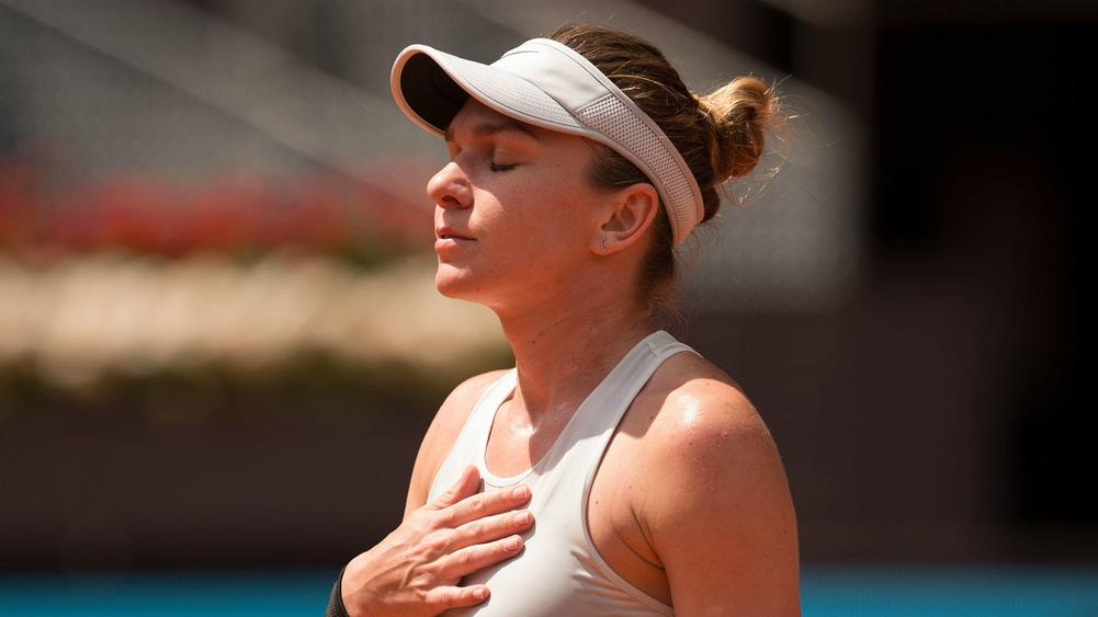 Halep sails past Mertens at Madrid Open, Del Potro wins on return