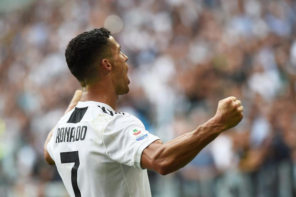 Juventus' Cristiano Ronaldo celebrates scoring his second Serie A goal during 2-1 win over Sassuolo.